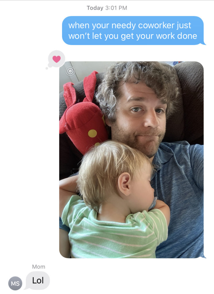 "Text message with picture of baby sleeping on dad, text reading ""when your needy coworker won't let you get your work done"""