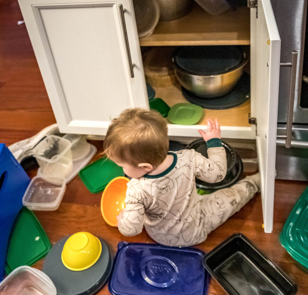 baby plays with pots and pans at home | working from home with a baby