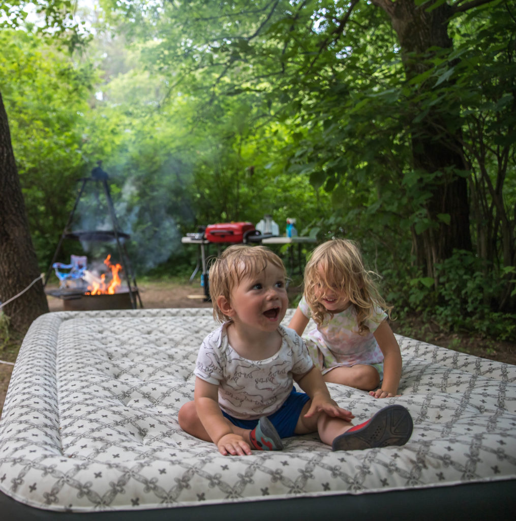 Kids playing on an air mattress at a Wisconsin campground