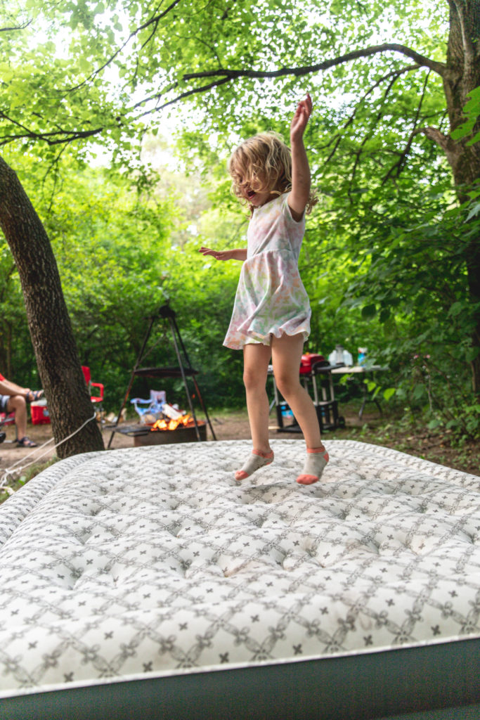 4-year old jumping on an air mattress while tent camping | camping activities for kids