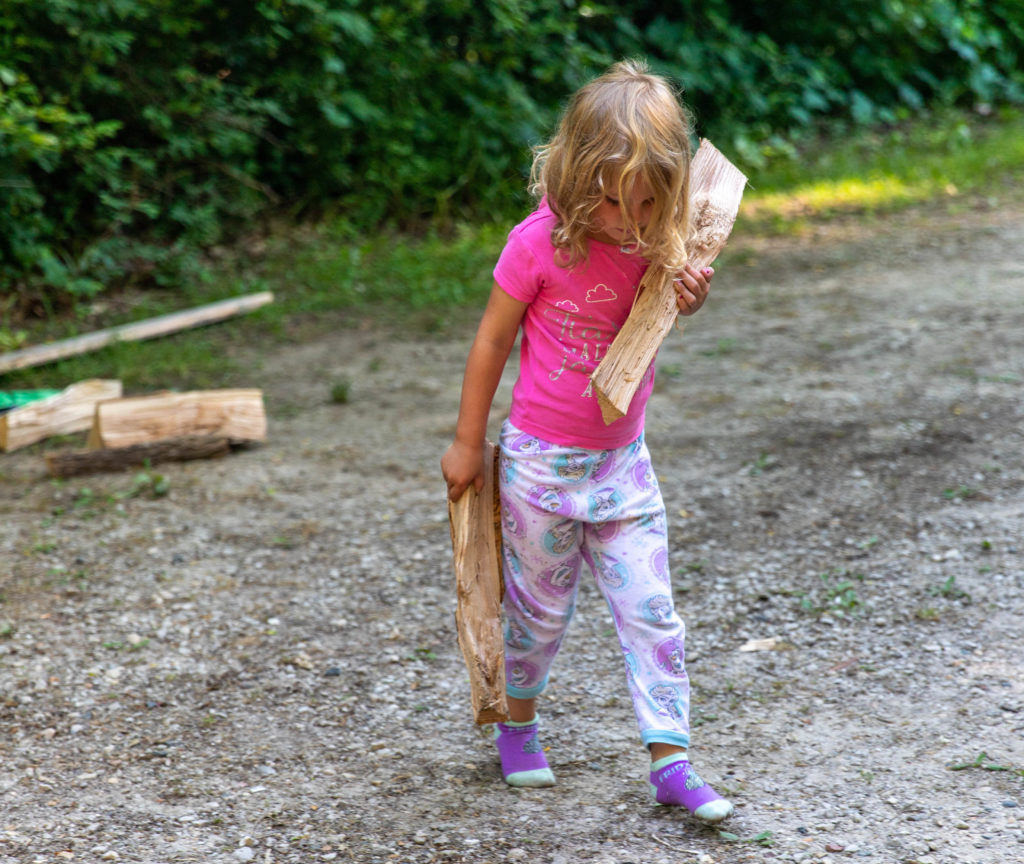 4 year old helping with chores while camping