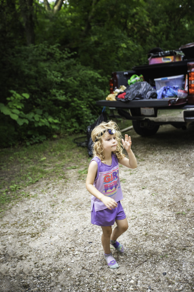 4 year old wear headlamp around campsite while tent camping
