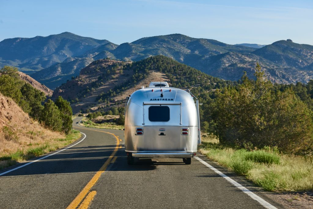 Classic Airstream trailer driving down the road