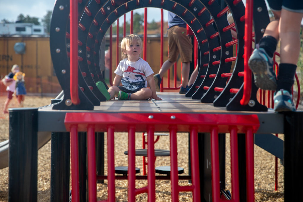 one year old at the playground at Jellystone Park Larkspur