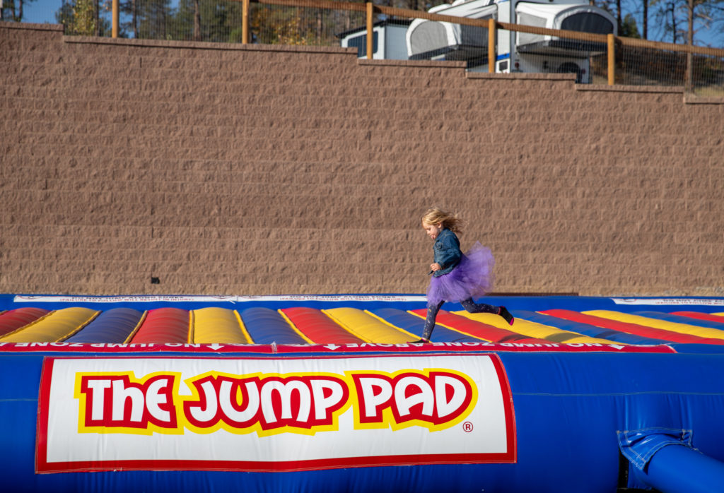 4 year old running on the jump pad at jellystone park larkspur