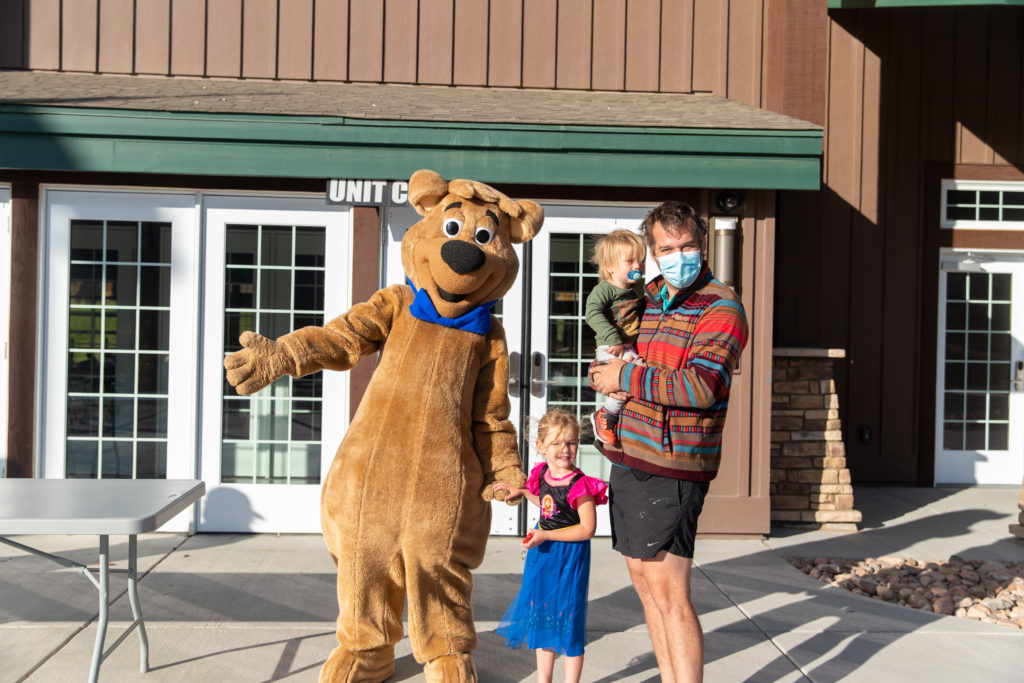 Family poses for a picture with Boo Boo at the Jellystone Park Larkspur