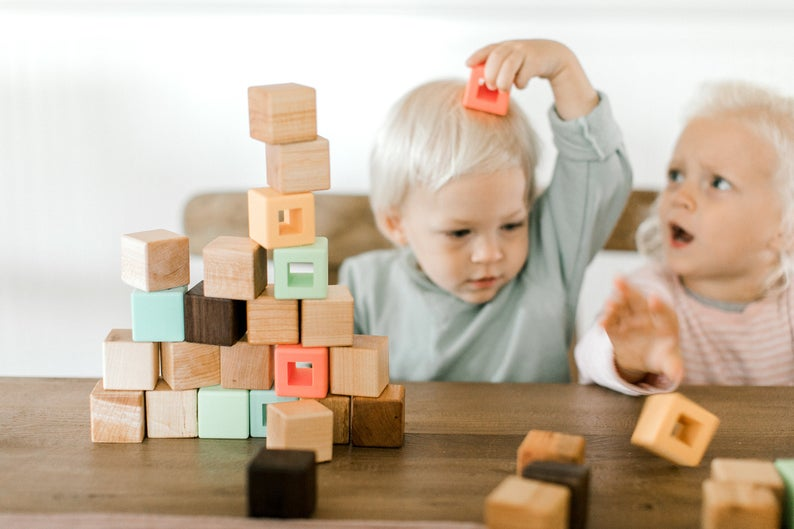 Wood and silicone block set for toddlers encouraging balance and stacking